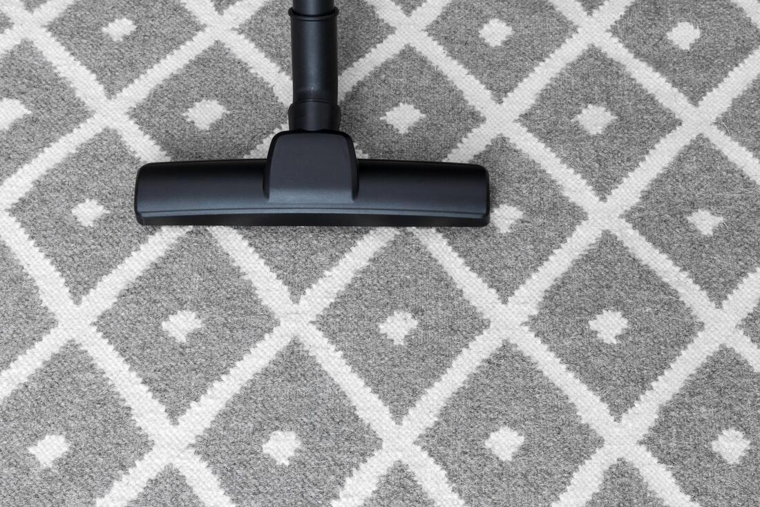 vacuum cleaner on carpet rug